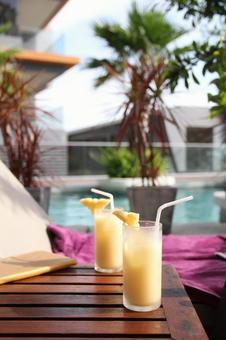 Two side-by-side pineapple juice