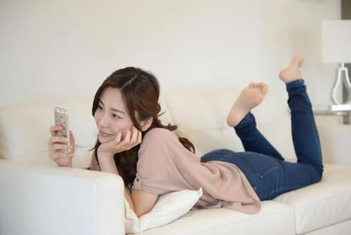 A woman relaxing on the sofa 13