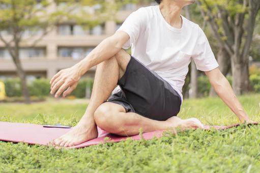 Men yoga outdoors