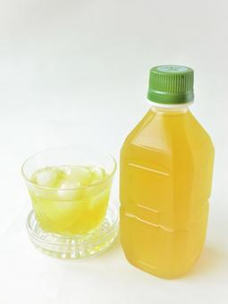 Pet bottle tea and glass vertical