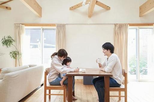 Asian family relaxing in the living room of a single house