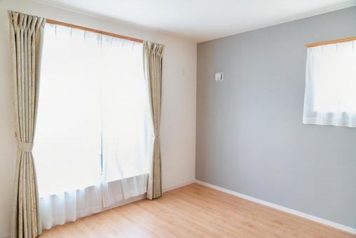 A photo of a bedroom in a condominium. New construction.