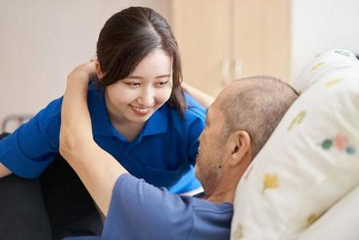 Female caregiver with an elderly person