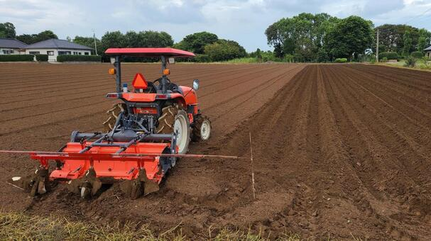 Fields cultivated with cultivators Image of agriculture Agricultural policy Fields SDGs Carbon neutral Sustainable food self-sufficiency tractor Material background