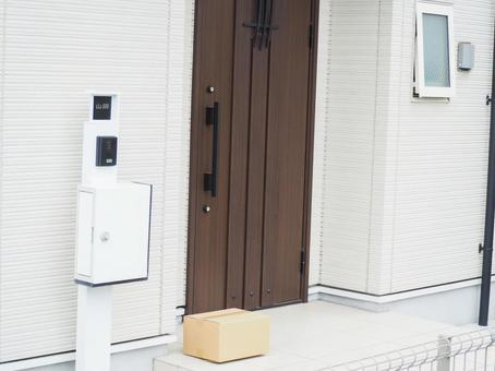 Delivered luggage placed in front of the house