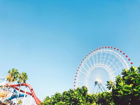 Amusement park Ferris wheel and pool waterslide