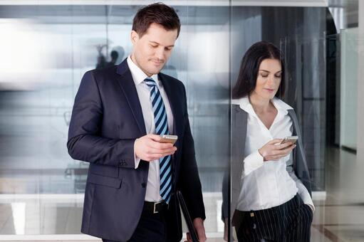 Businessman touching a smartphone 1