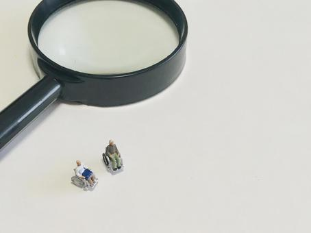 Elderly people in wheelchairs and magnifying glass (search / examine)