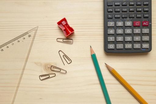 Pencil and pencil sharpening, clip and triangle ruler and calculator