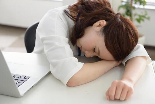 Career woman 6 sleeping at bed desk