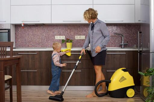Working mother with a son and a vacuum cleaner that imitates cleaning 17