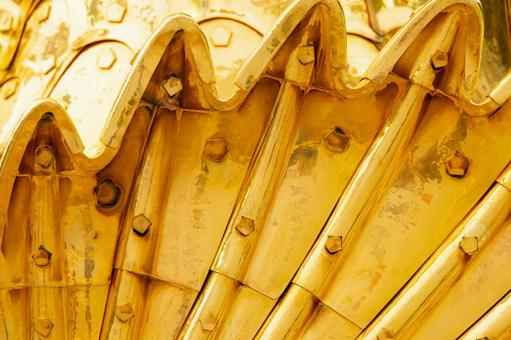 Gold killer whale fin