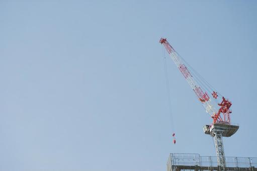 Tower crane on apartment construction roof