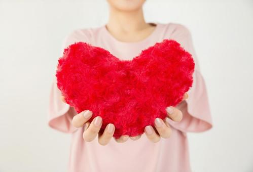 A woman with a heart