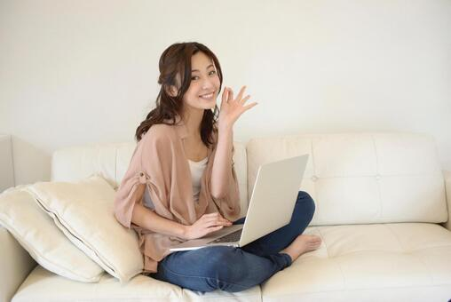 A woman touching a PC with a sofa 23