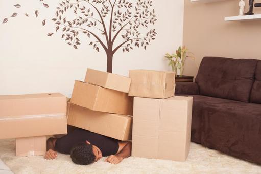 Men under cardboard