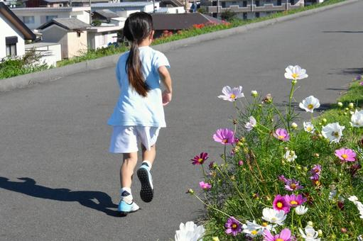 Back view of a running child