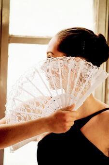 Female with folding fan 19