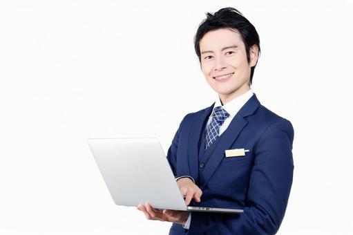 Hotel man using a laptop 1