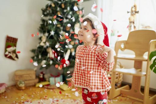 Christmas family Children standing in confetti