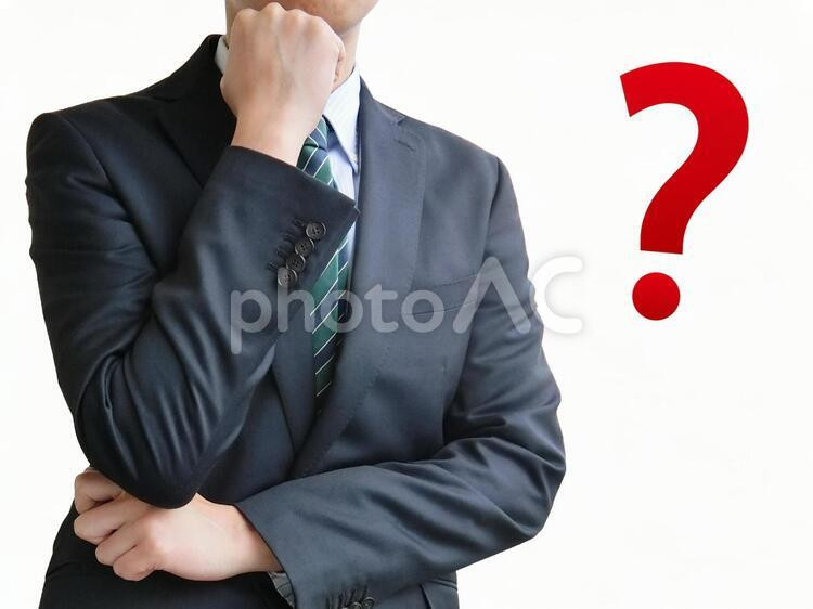 疑問に思うビジネスマン-白背景の写真