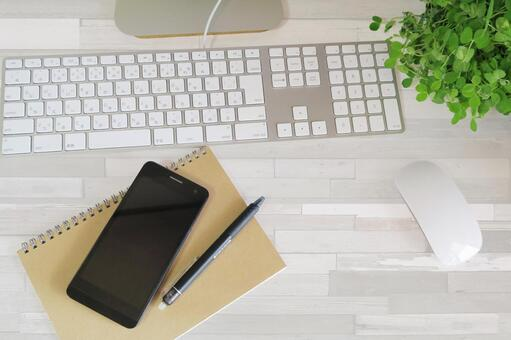 PC and smartphone workplace-white wood grain desk