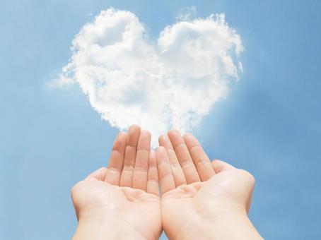 Heart cloud and saving hand