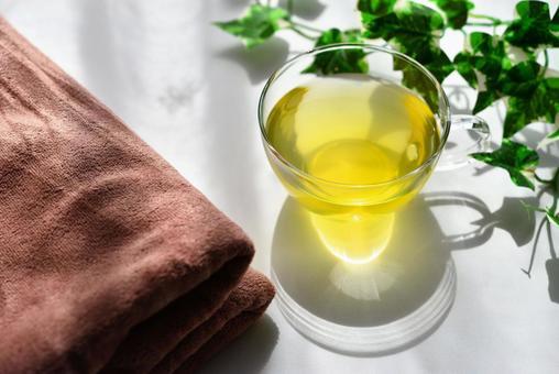 Herb tea and brown towel