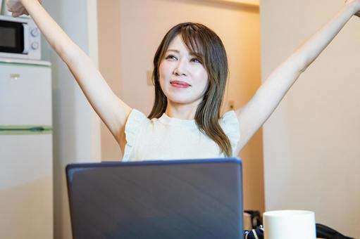 A woman who stretches after remote work