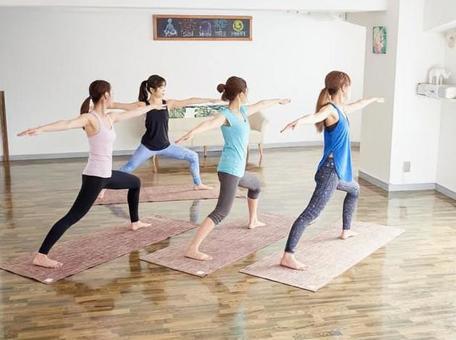 Asian woman posing hero in yoga