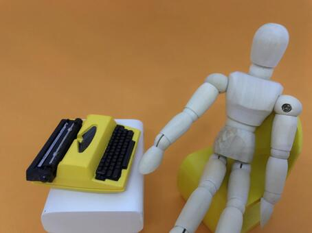 Typewriter and wooden doll (orange background), work / telework image