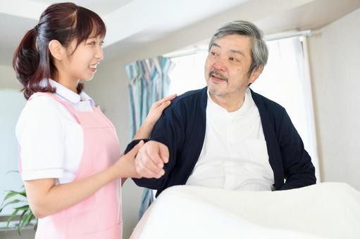 Bedridden elderly and caregiver women
