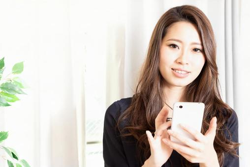 Smiling woman smartphone
