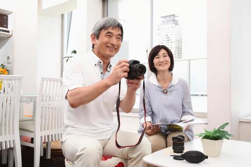 Senior men taking photos