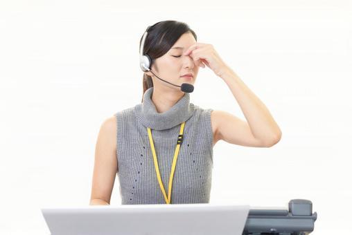 Tired female operator