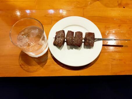 Shochu and beef skewers