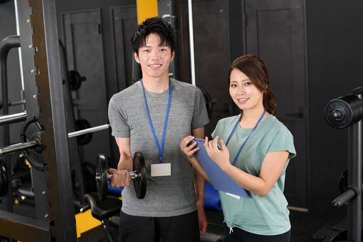 Men and women of gym instructors (trainers)