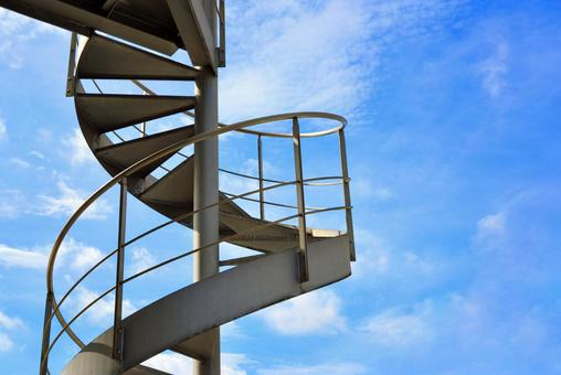 Spiral staircase and blue sky