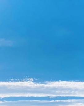 Horizontal clouds and blue sky