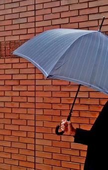 A man with an umbrella