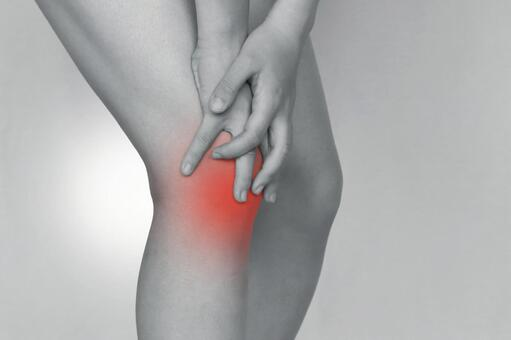 A woman holding a knee