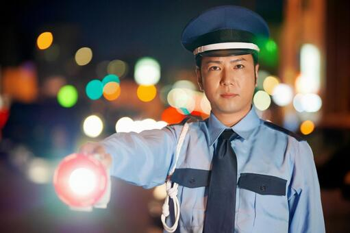 Security guard with a light