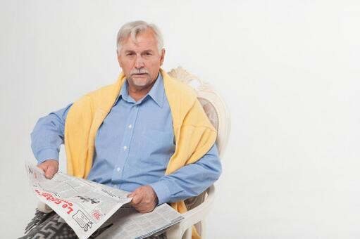 Sitting in a chair and reading a newspaper Foreigner Elderly Male 6