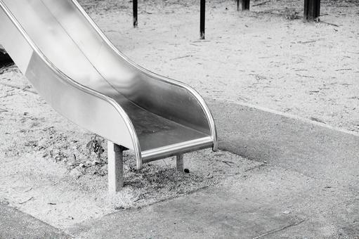 An empty park slide monochrome