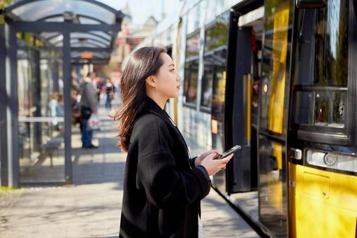 Tram and asian woman 1