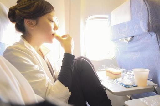Woman eating inflight meal