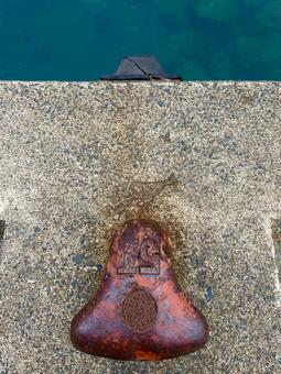 Bollard, concrete and sea