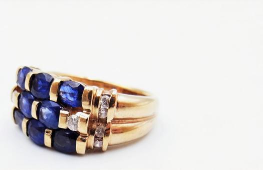 Beautiful ring of sapphire and diamonds Precious metal image