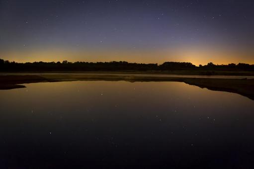 Starry sky reflected on the surface of the water