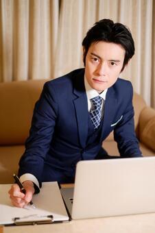 Hotel Man 18 using a laptop